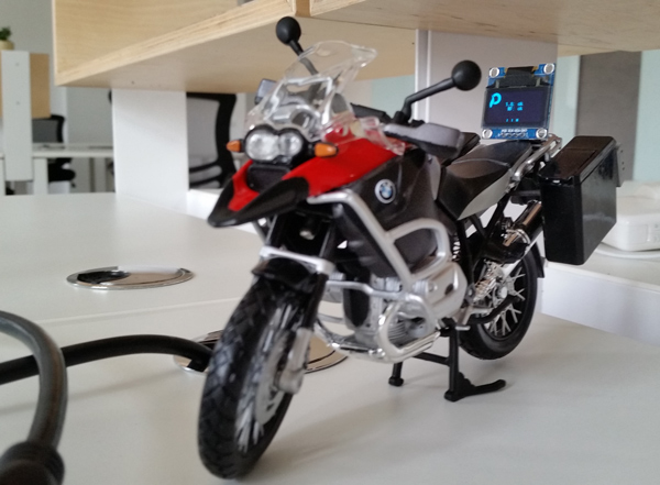 Office Status mounted on motorcycle toy